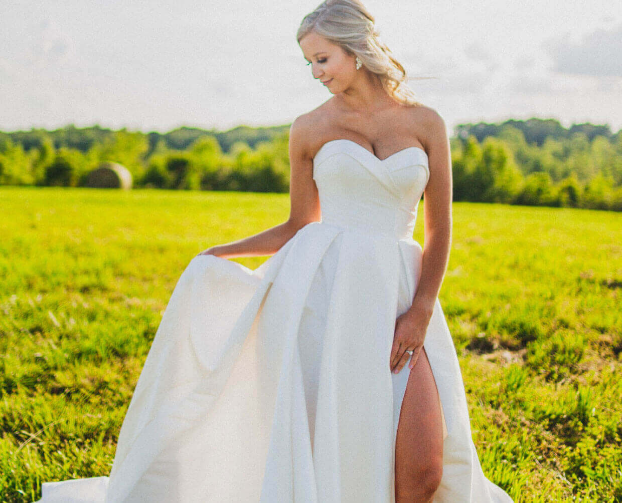 Photo of bride wearing a white sleeveless gown